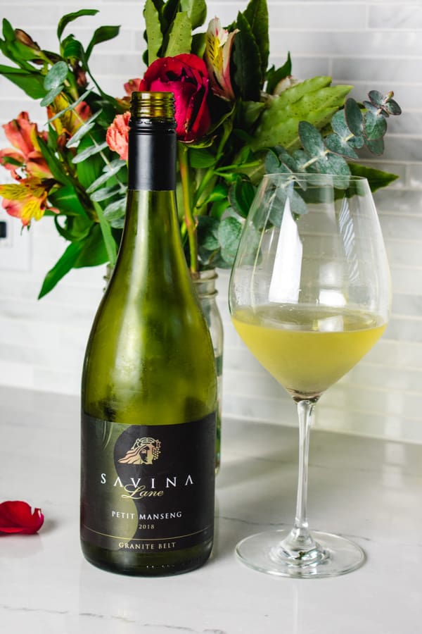 Savina Lane bottle and glass of Petit Manseng