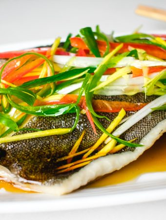 chinese steamed fish on a white platter