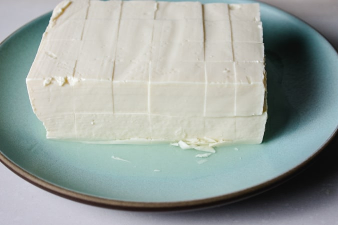blue plate with silken tofu cut into squares