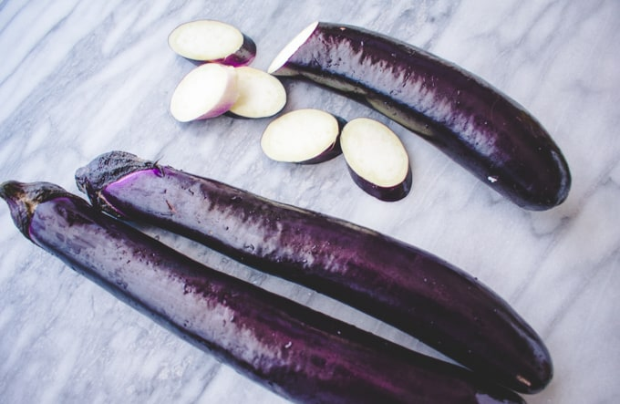 Chinese Eggplant sliced on marble board