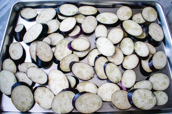Slices of Chinese eggplant on sheet pan