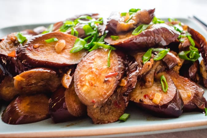 Chinese sichuan eggplant with green onion garnish