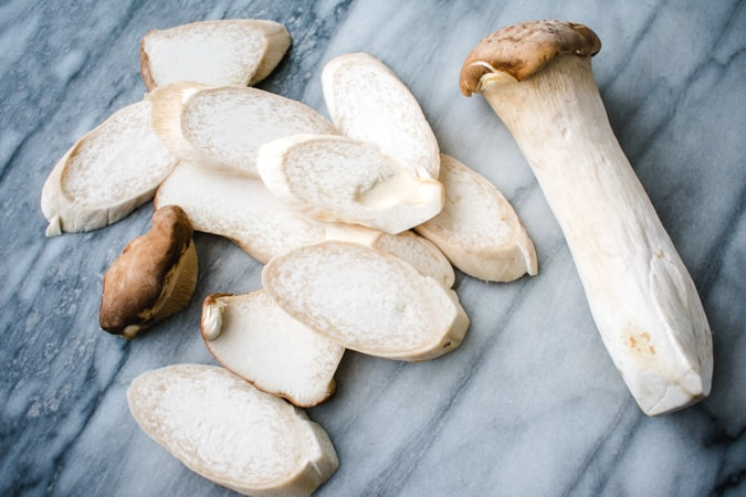 king oyster mushrooms on a marble board