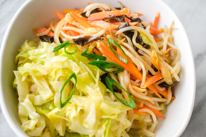 stir fried cabbage and mixed vegetables in a bowl