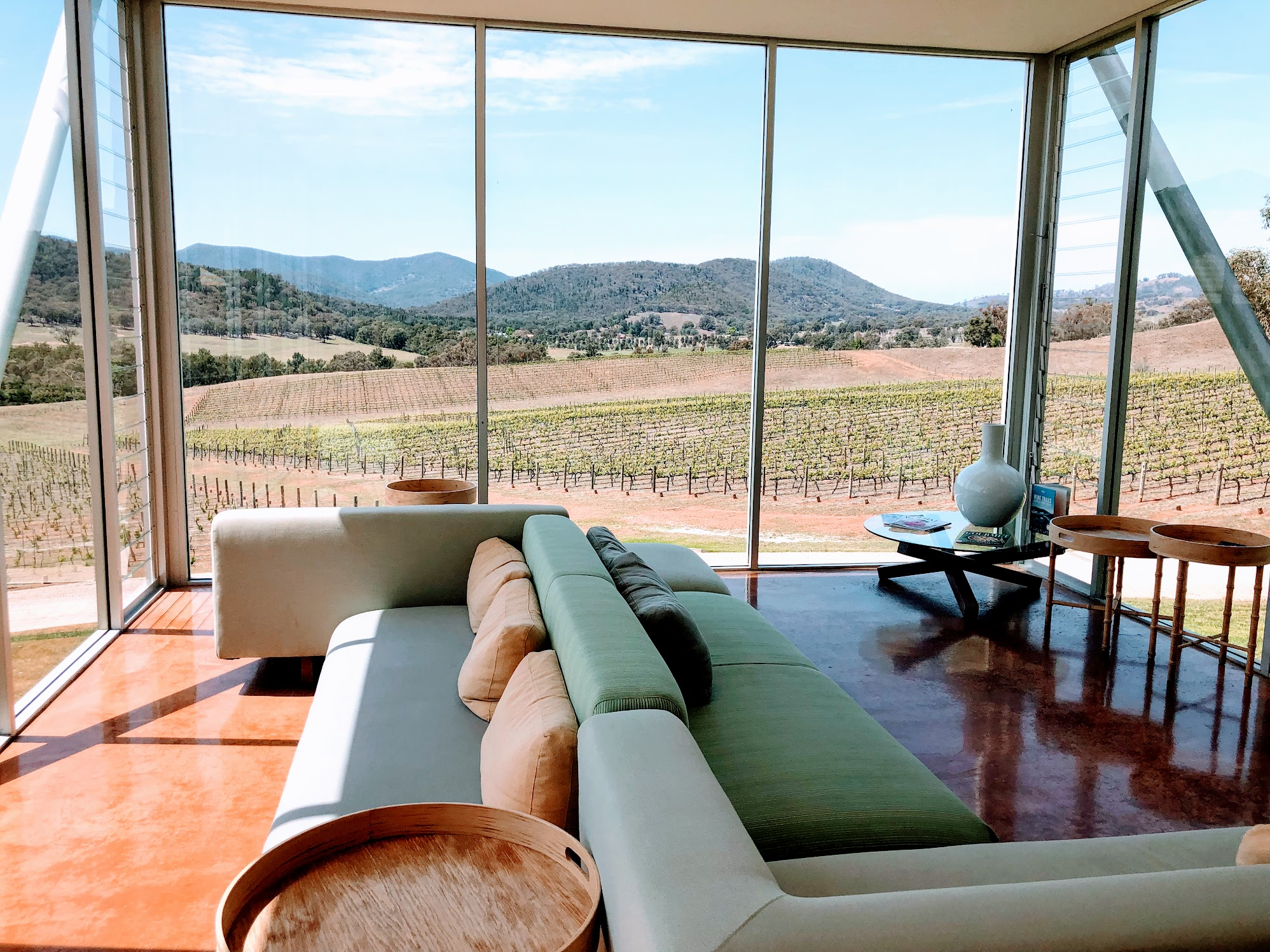 Comfy couches against a backdrop of the vineyards at Logan wine tasting room