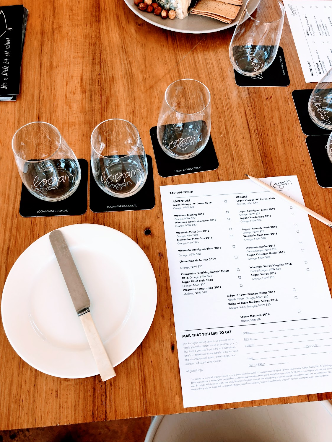 Logan wine flight with glasses and menu