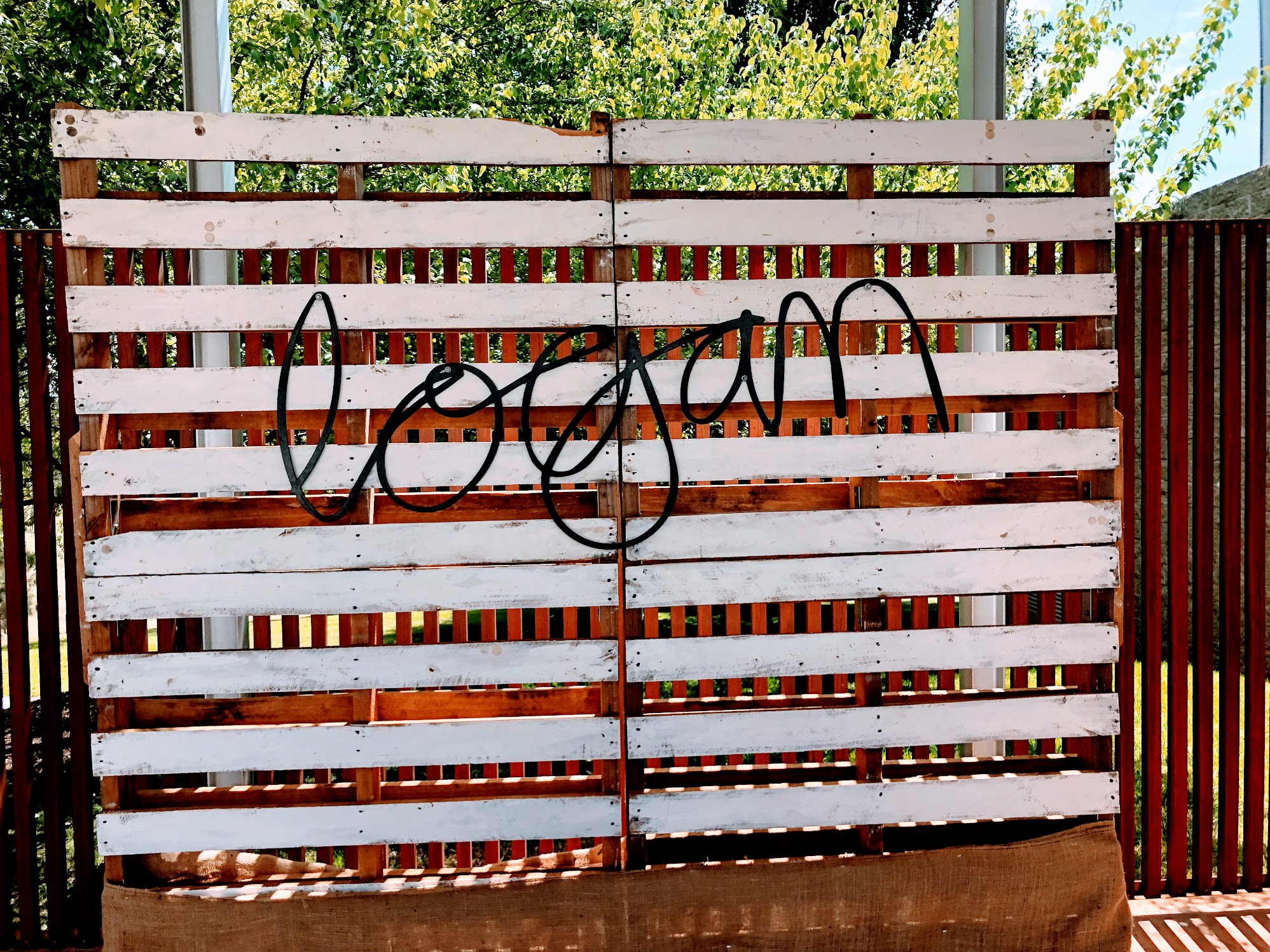 Logan Wine sign in cursive