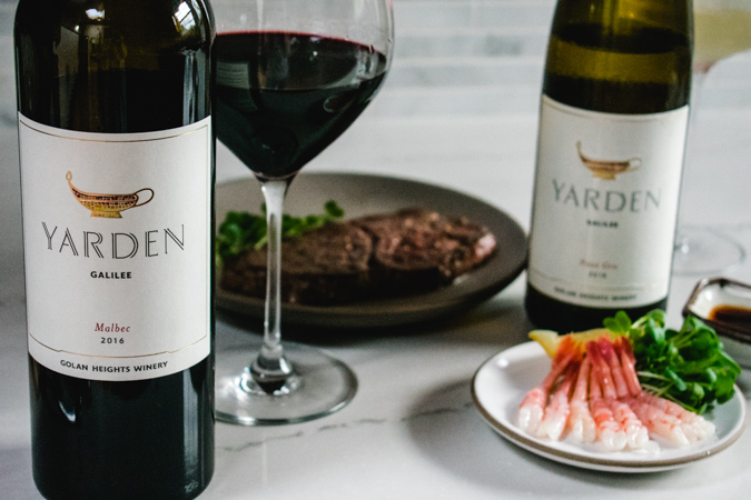 Yarden Wines with plate of raw shrimp and kobe steak