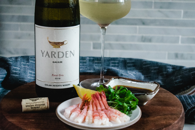 Yarden Wines pinot gris bottle and glass with plate of raw spot prawns