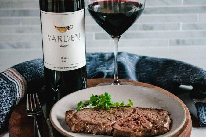 Kobe steak with glass and bottle of Yarden Wines Malbec