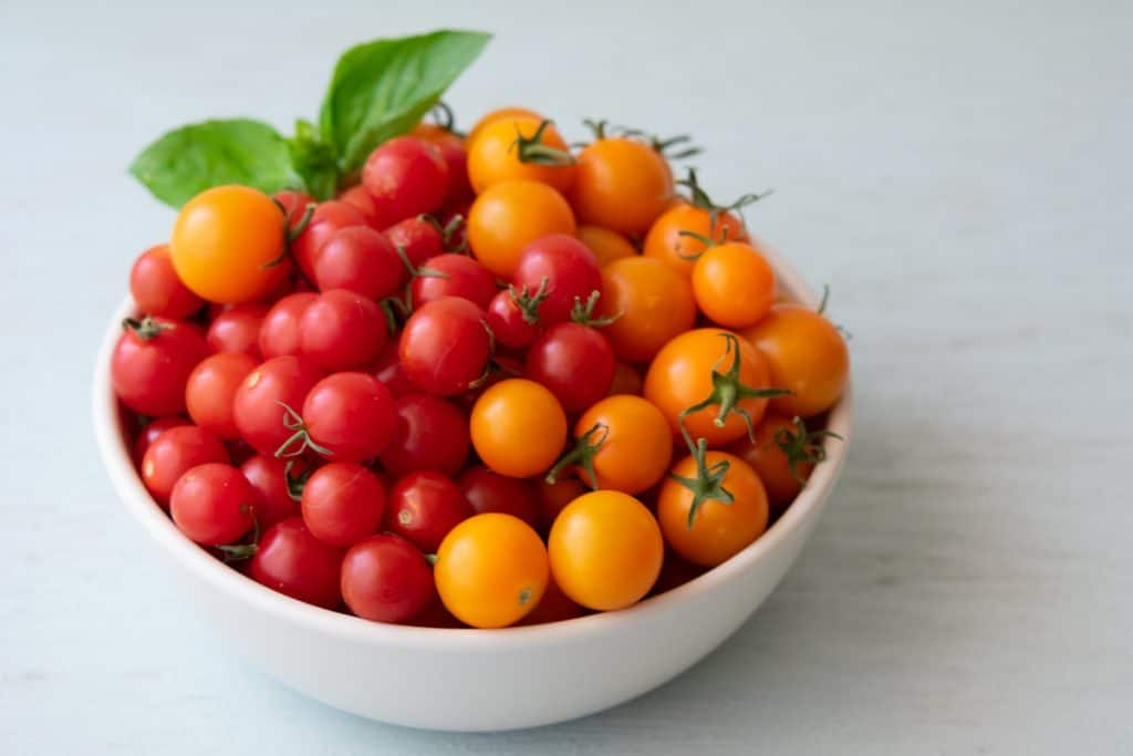 yellow and red cherry tomatoes in a bowl