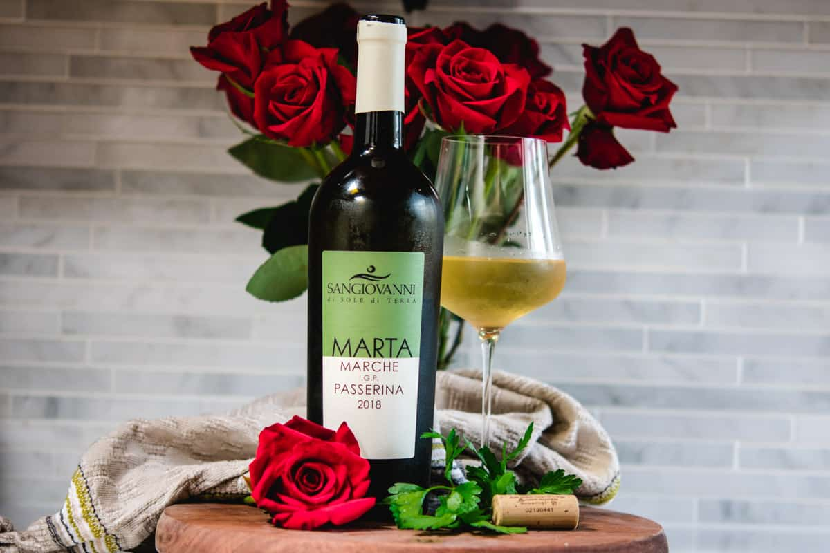Passerina white wine bottle and glass with red roses