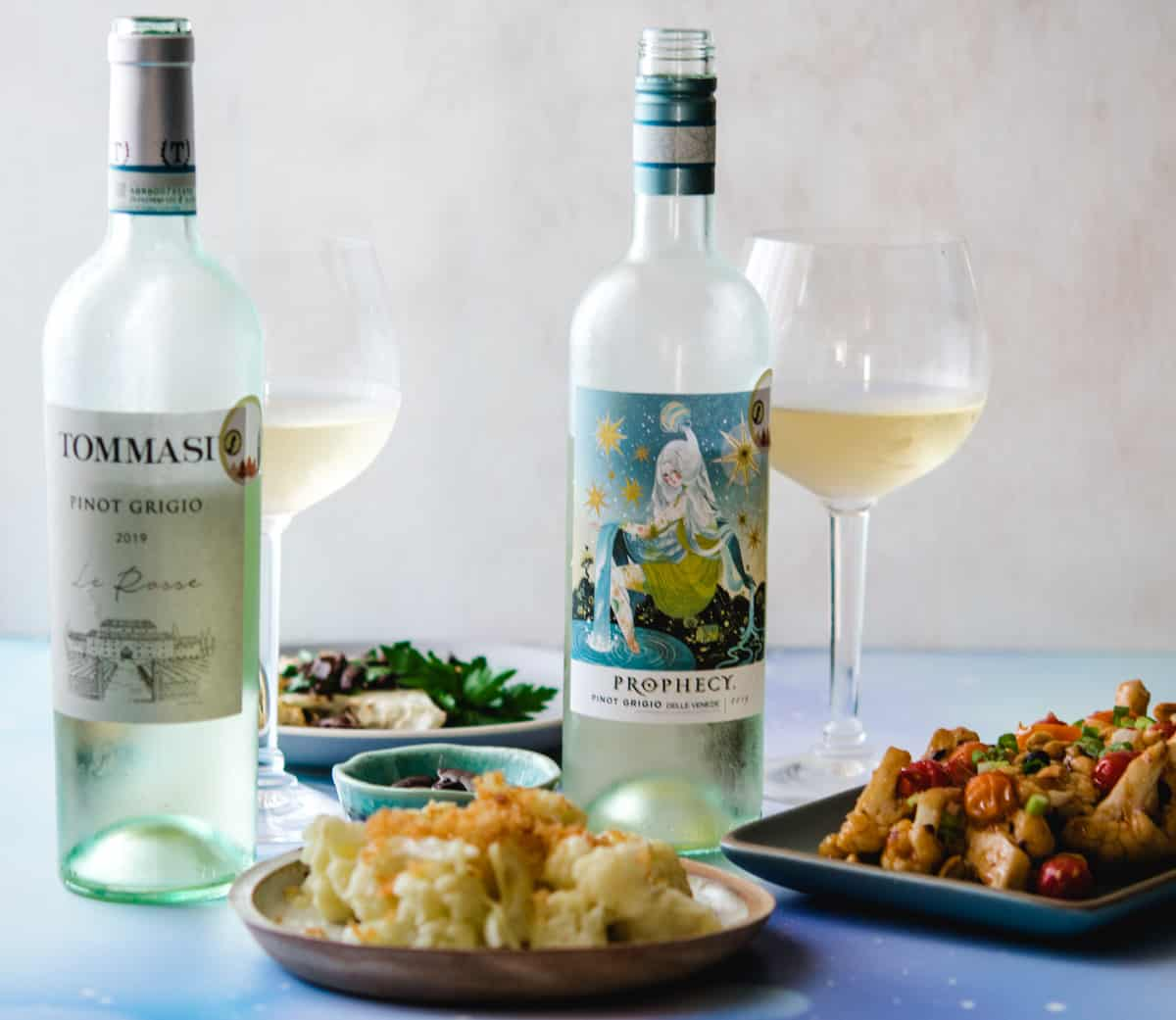 2 Italian pinot grigio bottles with 3 cauliflower dishes