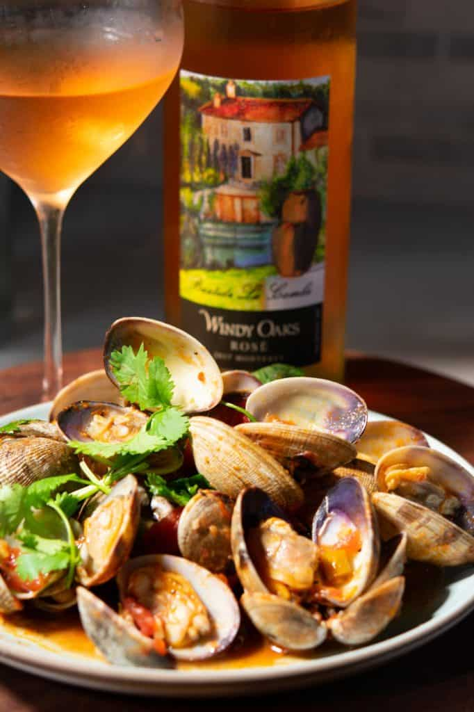 Spicy manila clams paired with Windy Oaks rose wine