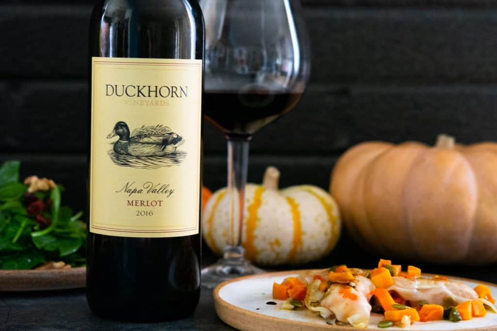 duckhorn merlot with butternut squash dumplings and pumpkins in the background