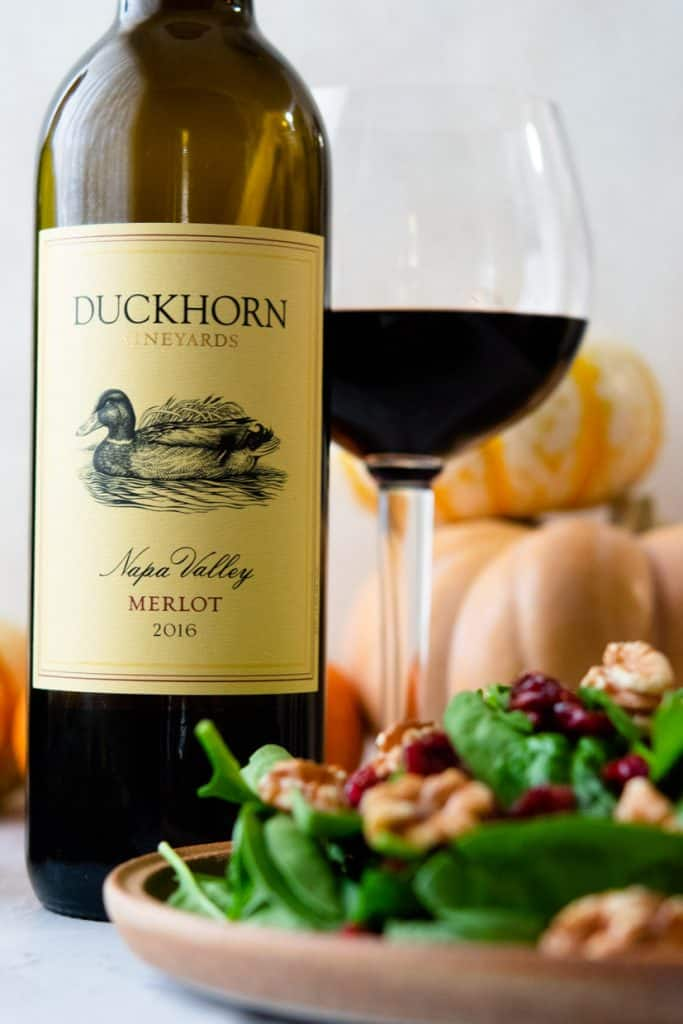 duckhorn merlot with spinach salad in the foreground