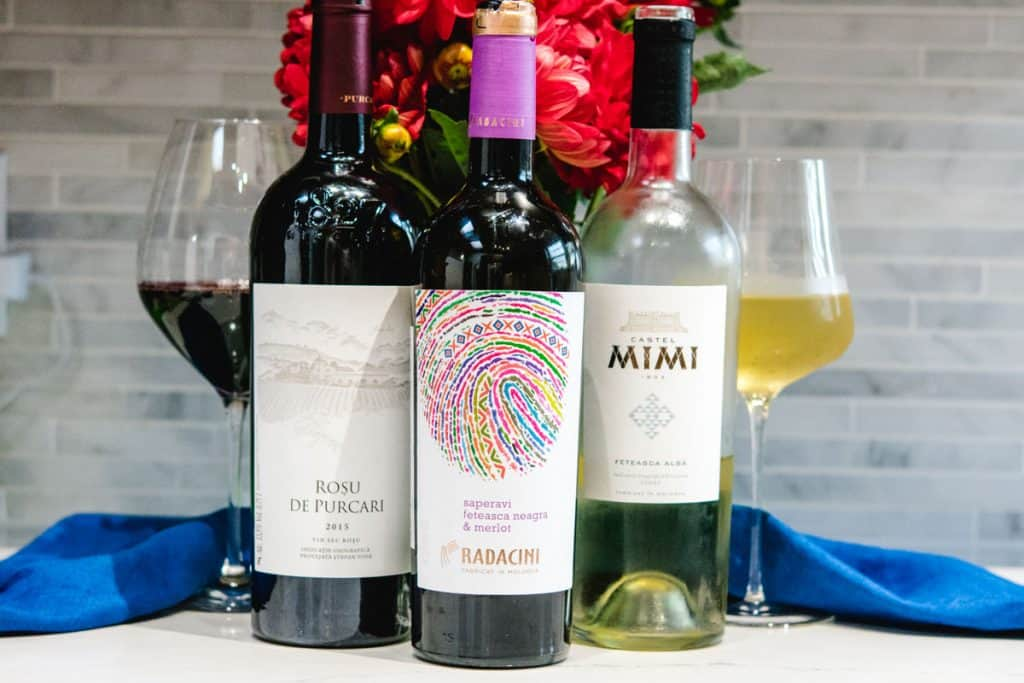 3 moldovan wines with red dahlias in the back