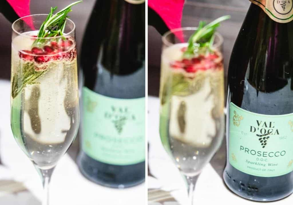 flute of prosecco with rosemary sprig and pomegranate seeds
