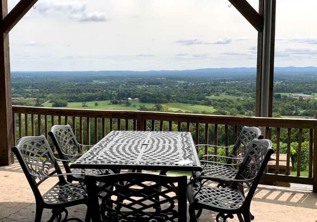 Empty table in front of a view at Bluemont Vineyard