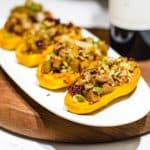 4 Vegan Stuffed Honeynut Squash on a long white plate