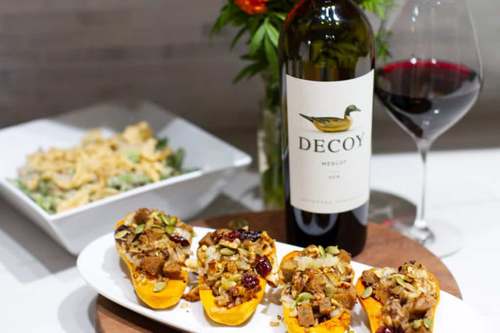 Decoy merlot wine with stuffed honeynut squash and green bean casserole in the background