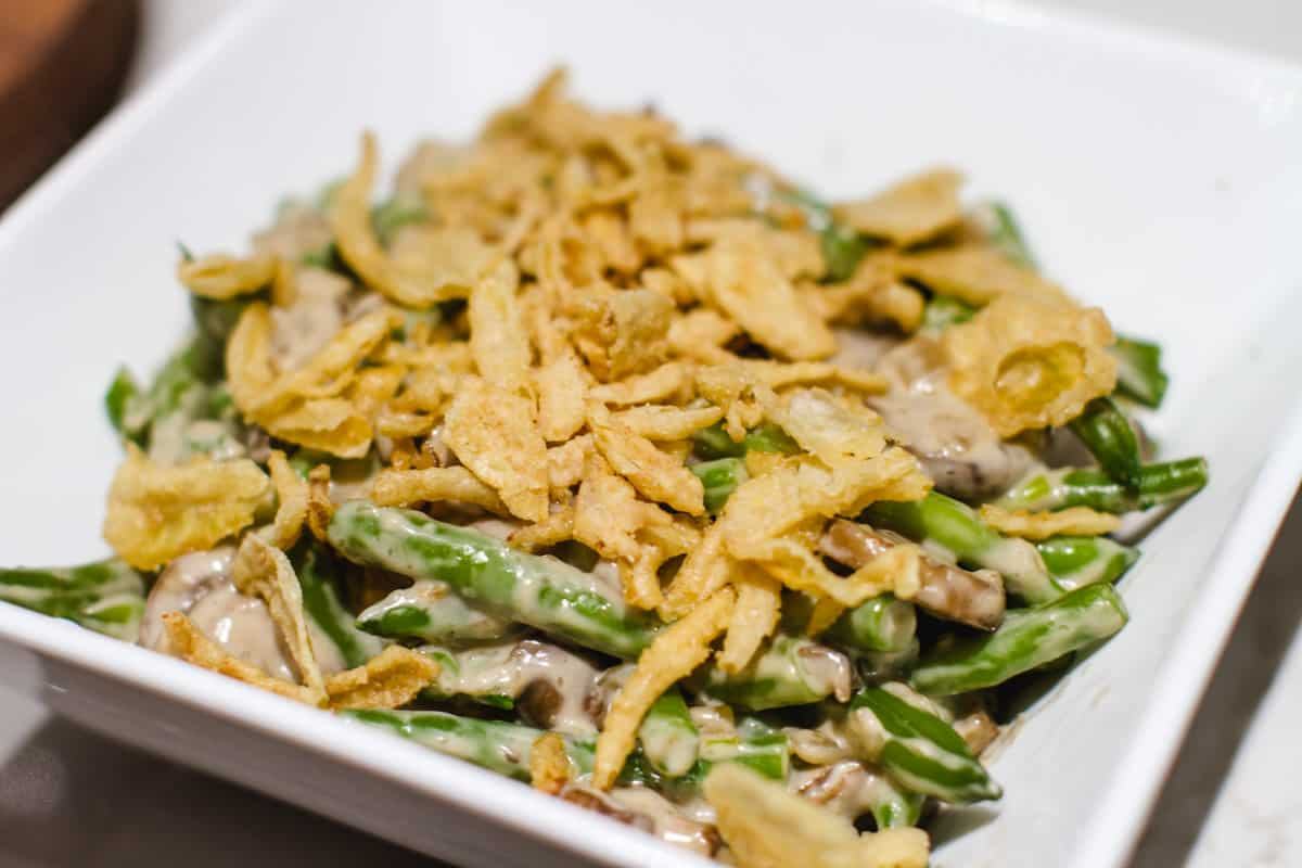 vegan green bean casserole in a white bowl