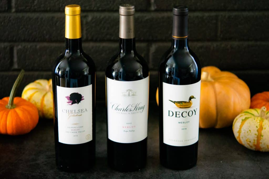3 merlot wines with pumpkins in the background