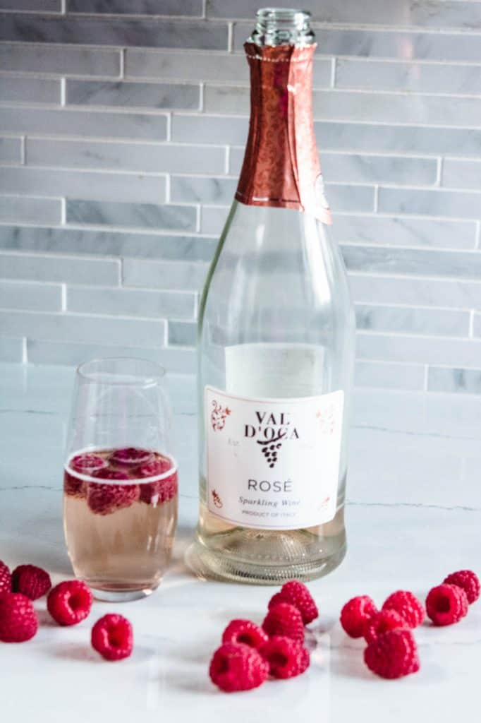 Val D'Oca sparkling rose wine and glass with raspberries