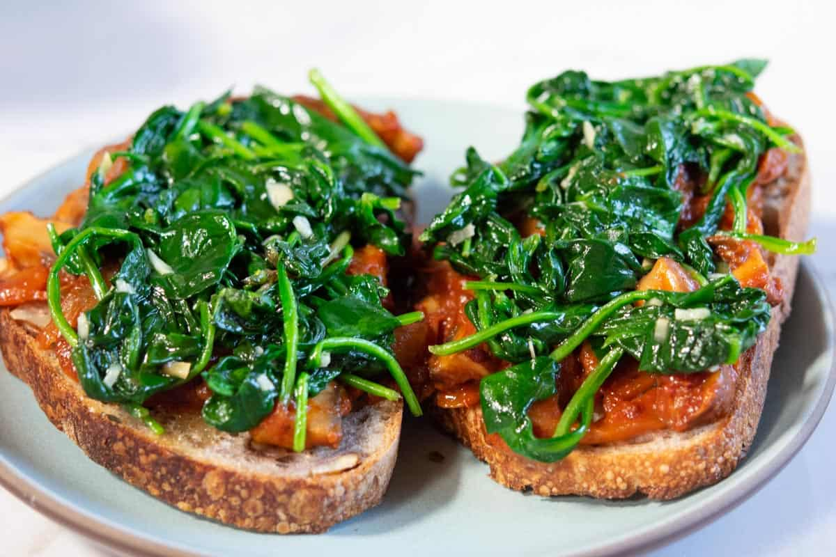 Spinach and mushrooms on toast