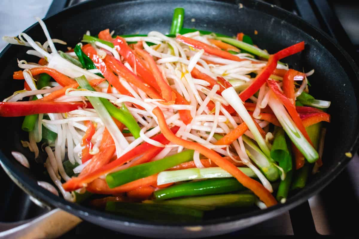 vegetables cooking in a nonstick pan