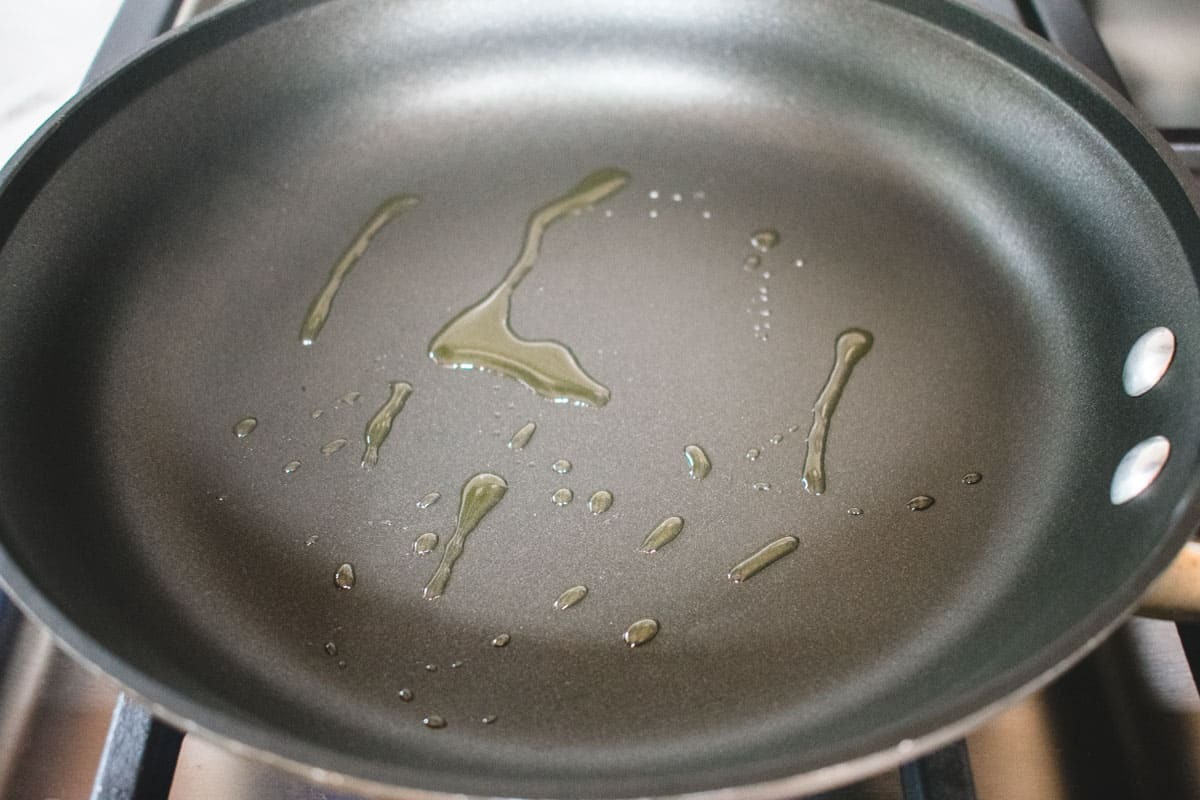 oil squirted over a nonstick pan