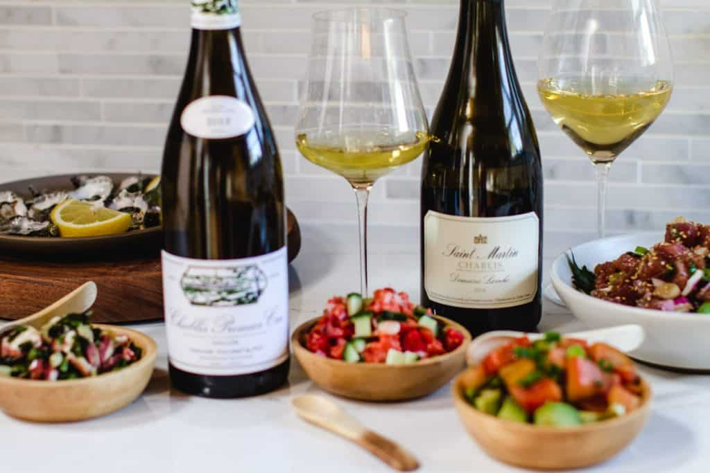 a quartet of hawaiian poke with 2 bottles of Chablis