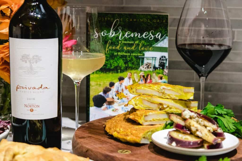Sobramesa book with glasses of wine and spanish tortilla and pickled eggplant