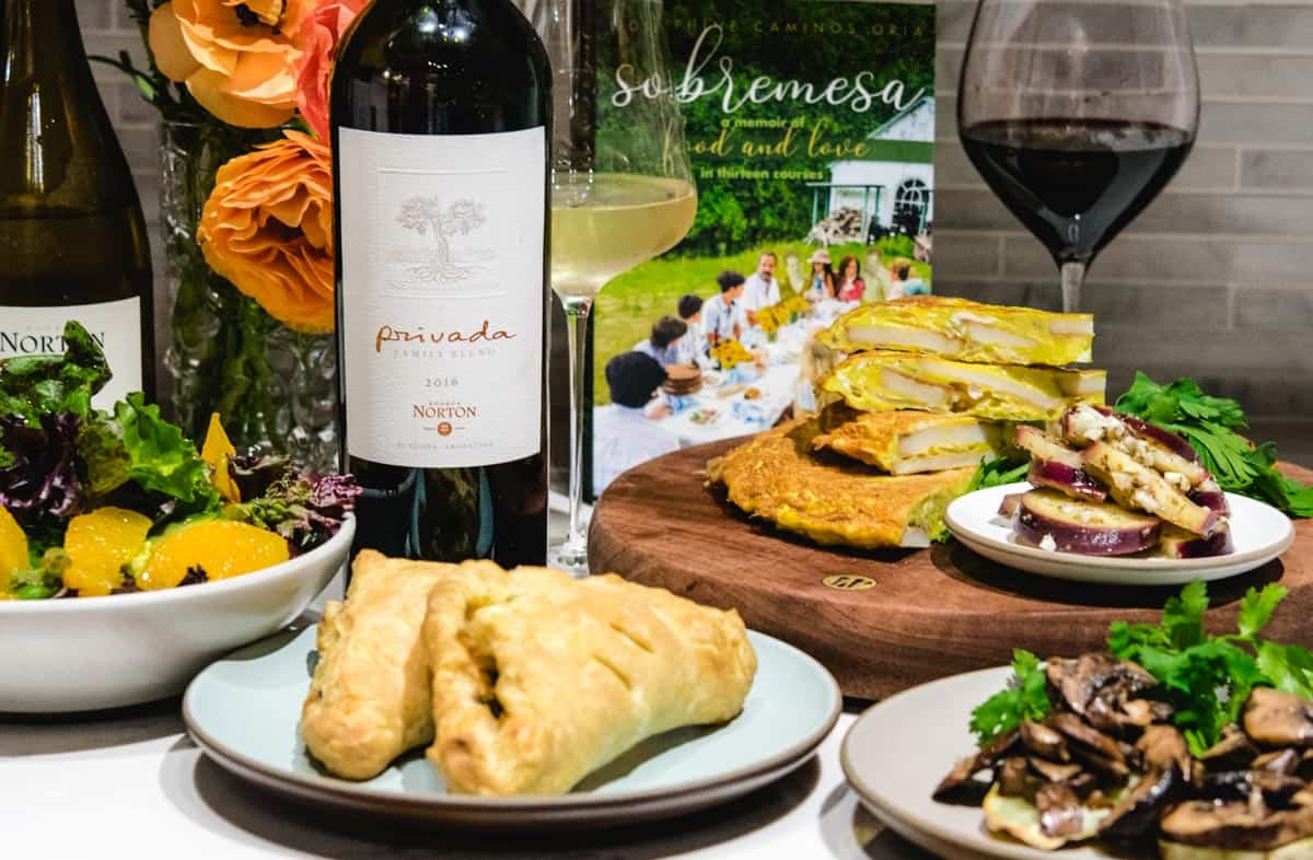 sobramesa book with wine and vegetarian plates of food