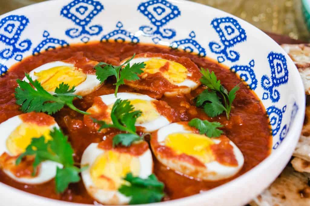 tomato egg curry in a bowl