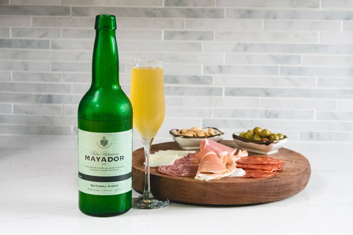 Mayador still cider with a charcuterie board